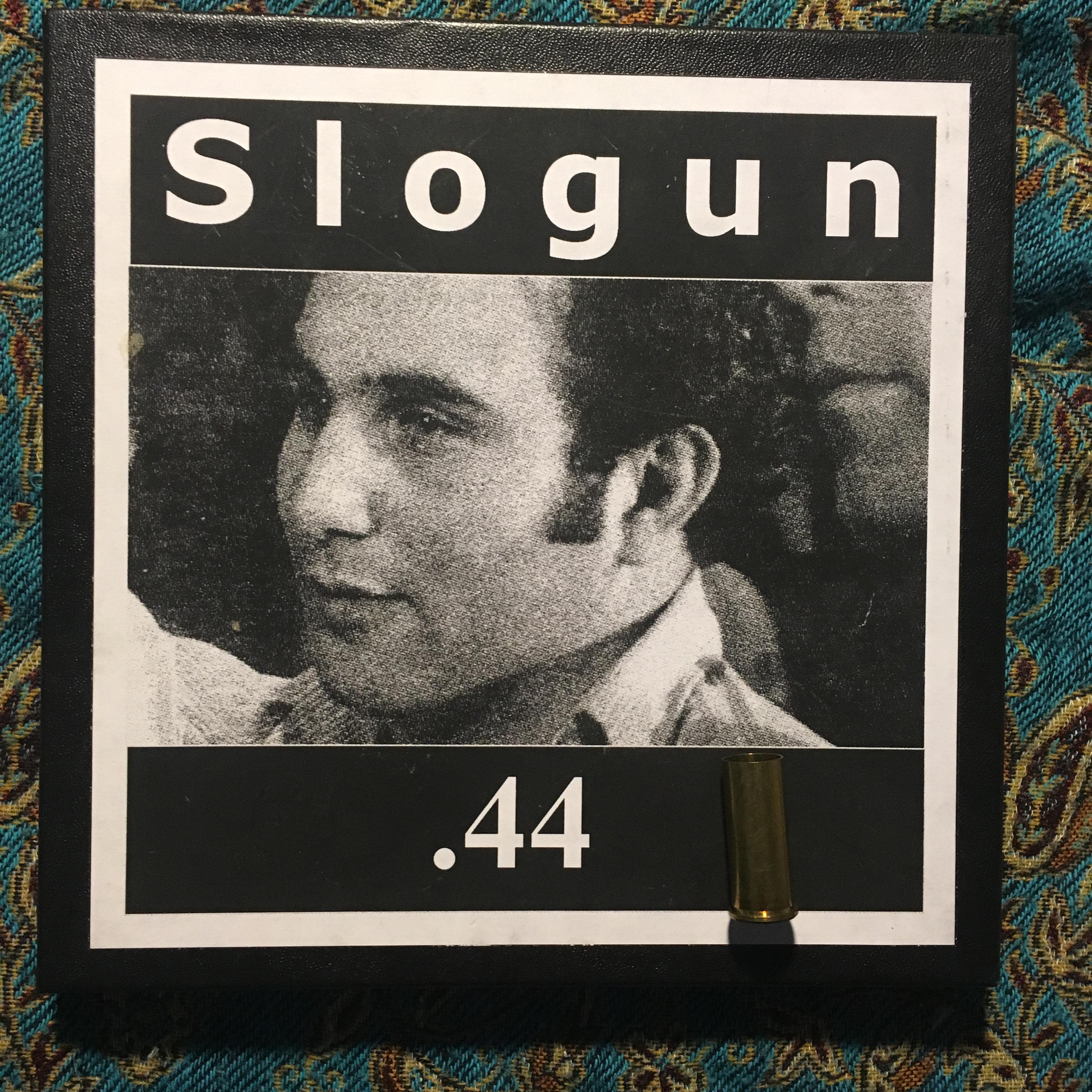 "SLOGUN – .44 (The Ultimate Evil) 7"" Box (+ shell casing)"
